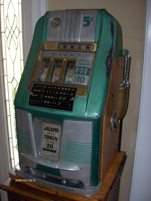 Mills token bell slot machines how to launder money through casino